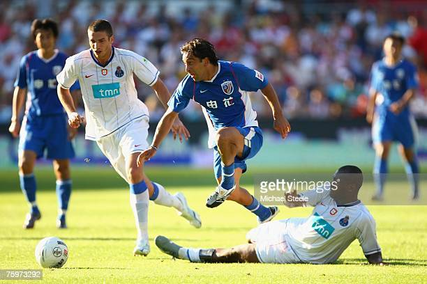 Blanco Soto of Shanghai skips the challenge of Joao Paulo watched by Stepanov during the Port of Rotterdam Tournament match between FC Porto and...
