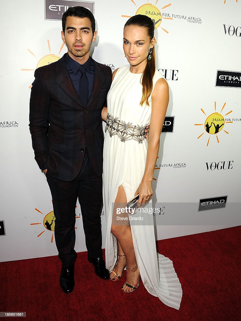 Blanda Eggenschwiler and Joe Jonas arrives at the Gelila And Wolfgang Puck's Dream For Future Africa Foundation Gala at Spago on October 24, 2013 in Beverly Hills, California.