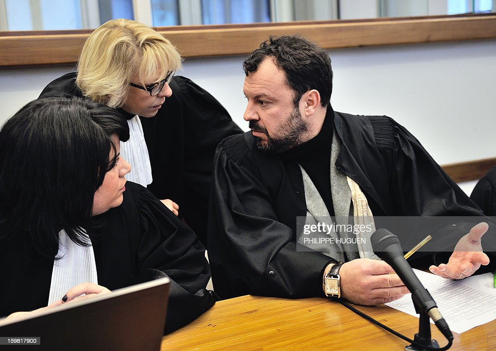 Blandine Lejeune (2nd L), the lawyer of Anne-Sophie Faucheur (unseen), talks with Emmanuel Riglaire (R), the lawyer of Nicolas Willot (unseen), at the Douai courthouse, northern France, on January 21, 2013, before the trial of the mother and stepfather of Typhaine, Anne-Sophie Faucheur and Nicolas Willot, in connection with the girl's death. The body of Typhaine was found in December 9, 2009, in a suburb of the southern Belgian city of Charleroi, and Faucheur and Willot finally recognized that she had died at their house on June 10, 2009, and that her body had been buried somewhere in Belgium.