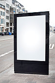 Blank advertising billboard on city street - copy space