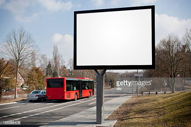 Blank advertising billboard on city street, passing cars
