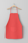 Blank red apron with pocket on hanger isolated with clipping path around apron. 3d illustration