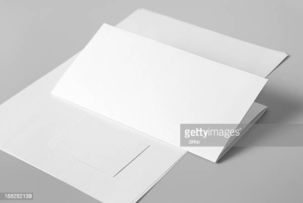 Blank basic stationery. Letterhead flat and folded, business card.