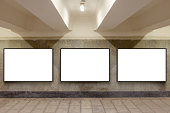 Three blank billboard advertisement posters on underground wall. 3d illustration