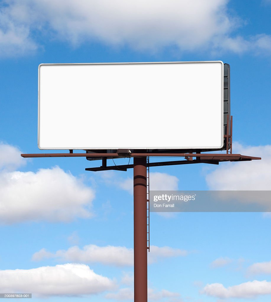 Blank billboard against blue sky (Digital Composite) : Stock Photo