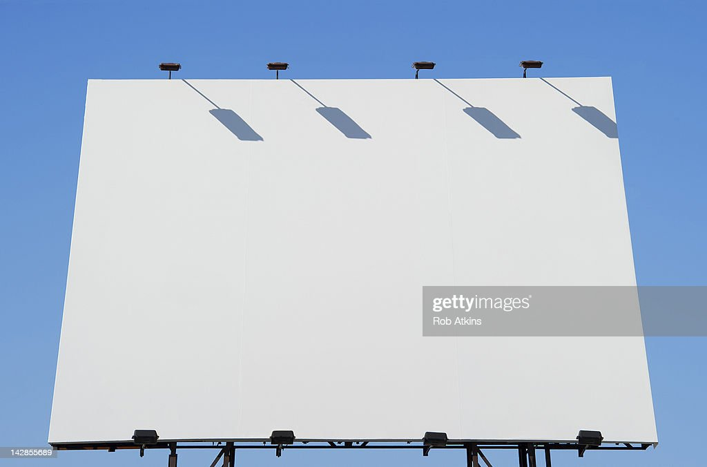 Blank billboard and blue sky : Stock Photo