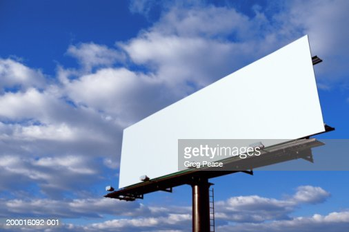 Blank billboard, clouds in blue sky, low angle view : Foto stock
