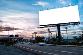 Blank billboard for outdoor advertising at twilight time