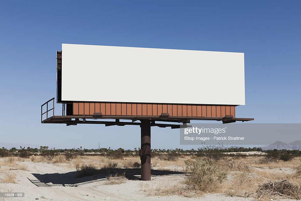 A blank billboard in a desert : Photo