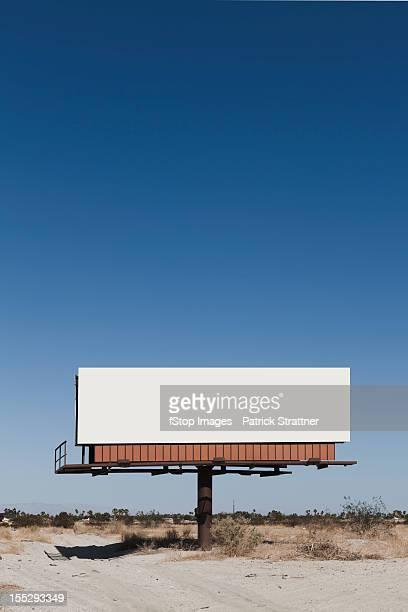A blank billboard in a desert
