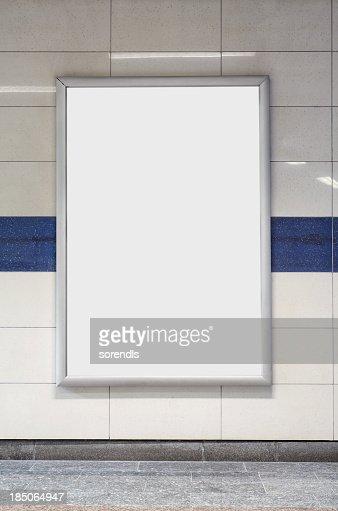 Blank billboard in a subway station wall.