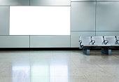 Blank billboard in airport waiting area.