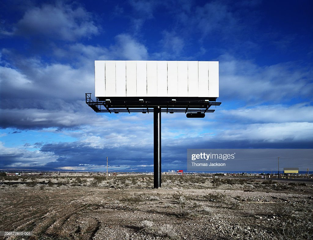 Blank billboard in desert : Photo