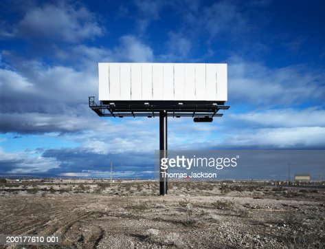 Blank billboard in desert