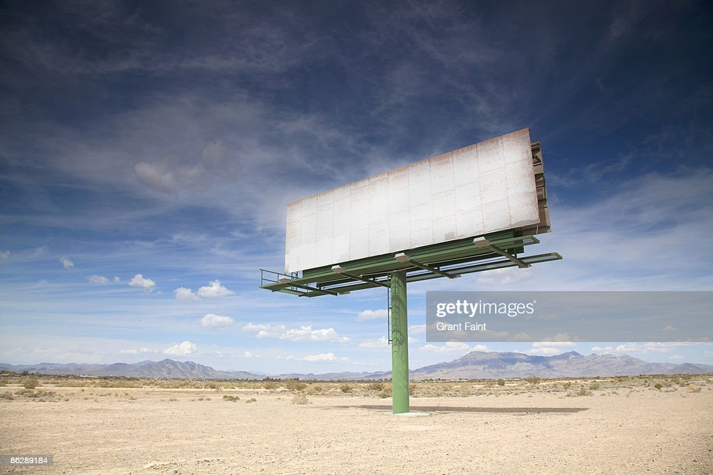 Blank billboard in desert : Stock Photo