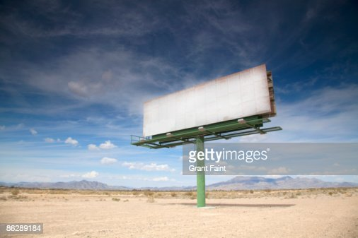 Blank billboard in desert : Foto stock