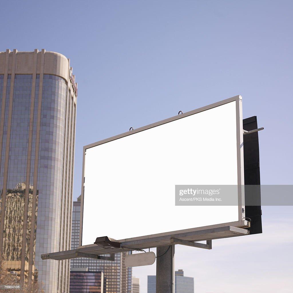 Blank billboard in downtown setting : Stock Photo