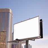 Blank billboard in downtown setting