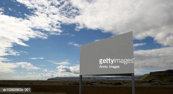 Blank billboard in field : Stock Photo