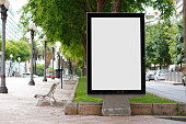 Blank billboard mock up in a park