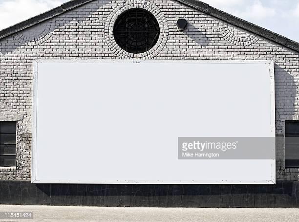 Blank Billboard On Brick Building