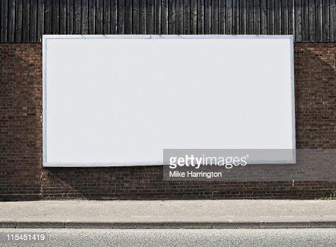 Blank Billboard On Brick Wall