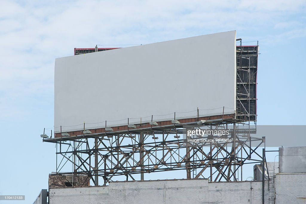 Blank billboard on roof of building : Stock Photo