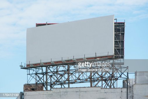 Blank billboard on roof of building