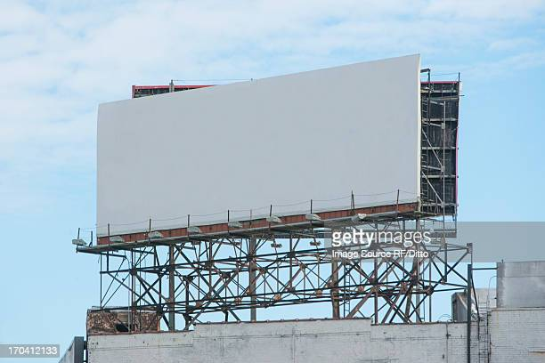 Blank billboard on roof of building