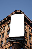 Blank billboard on the corner of an apartment block
