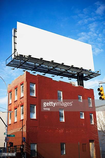 Blank billboard on urban building