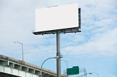 Blank billboard over freeway