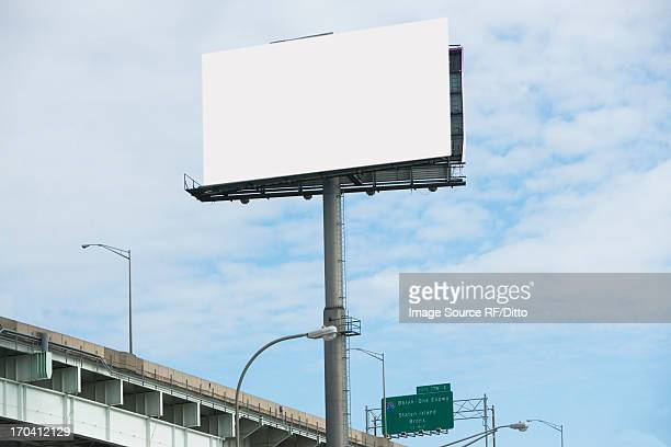 Blank billboard over freeway