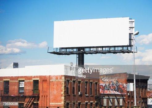 Blank billboard over urban buildings