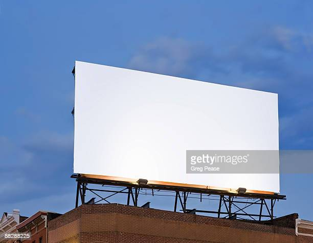 Blank Billboard Sign on Building Rooftop