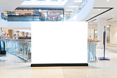 Blank billboard with copy space for your text message or content in shopping mall and luxury clothing derpartment store for background