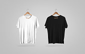 Blank black and white t-shirt on hanger, design mockup. Clear plain cotton tshirt mock up template. Apparel store logo branding display. Crew shirt surface hang on wood hanger