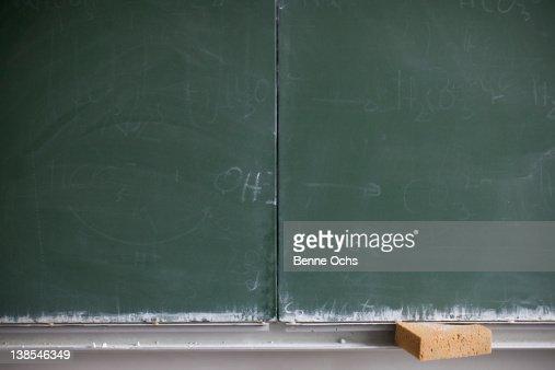 Blank blackboard and sponge