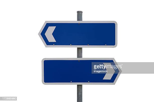 Blank blue and white signs pointing in different directions