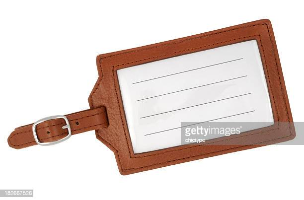 Blank, brown, leather luggage tag with white background