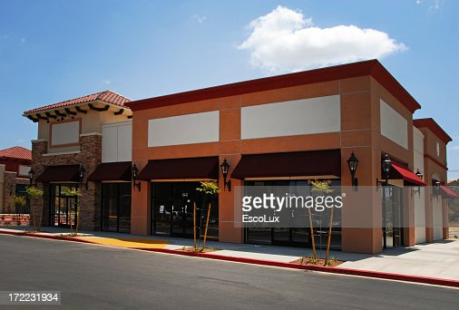 Blank building storefront with awnings