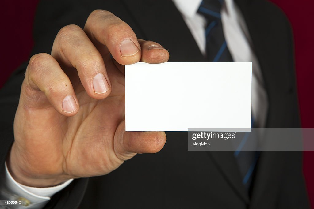 Blank business card in a hand : Stock Photo