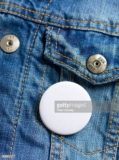 Blank button badge on denim jeans jacket.