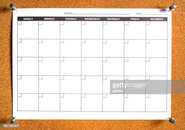 blank calendar on bulletin board