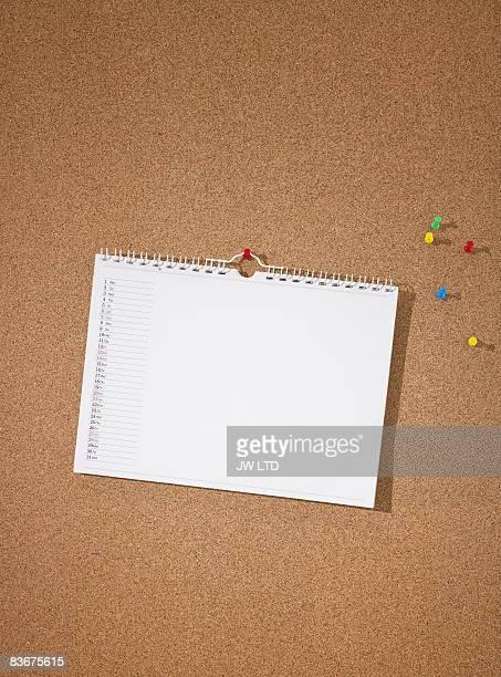 Blank calendar on pinboard
