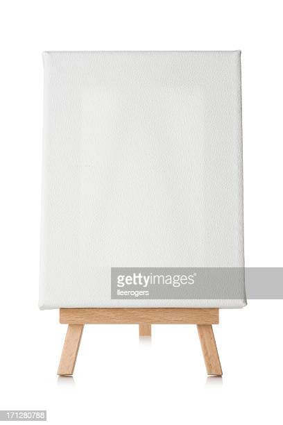Blank canvas and easel isolated on a white background