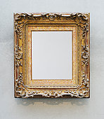 Blank canvas in gilded frame.