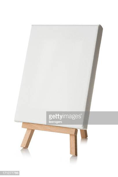 Blank canvas with wooden easel on a white background