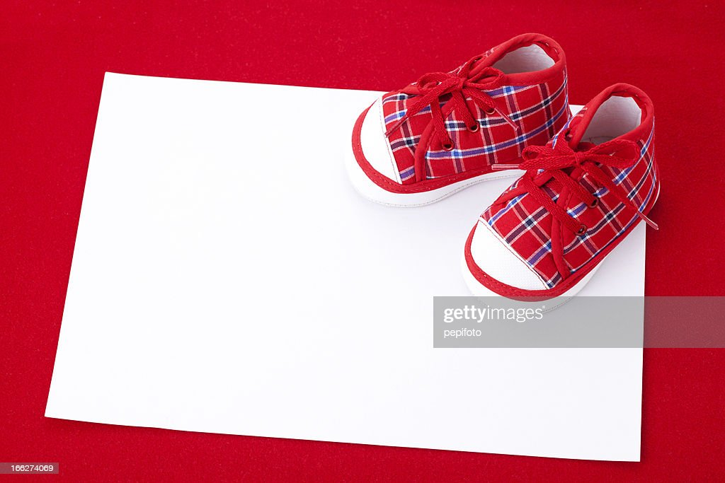 Blank card and  red Baby Booties : Stock Photo