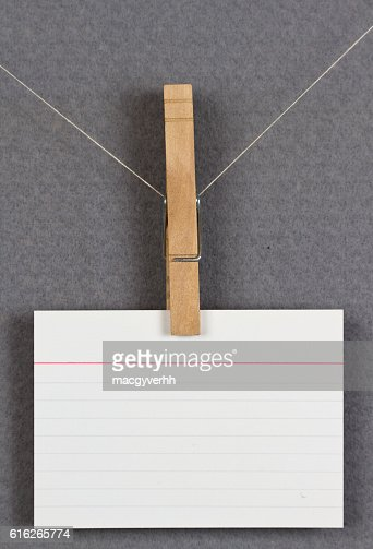 blank card pinned up on a pinboard : Stock Photo